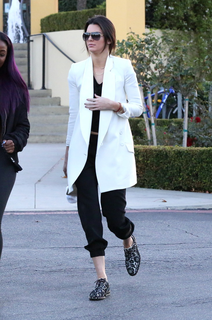 Kendall Jenner was spotted at Sugarfish in Calabasas, enjoying a mellow afternoon with friends. The reality star went with a black outfit under a white sports coat, on Saturday, January 3, 2015, X17online.com