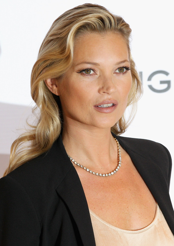 LONDON, ENGLAND - JANUARY 24: Model Kate Moss poses for photographs at the Mango Store Oxford Street on January 24, 2012 in London, England. Kate Moss was today launched as the new face of the fashion brand. (Photo by Chris Jackson/Getty Images)