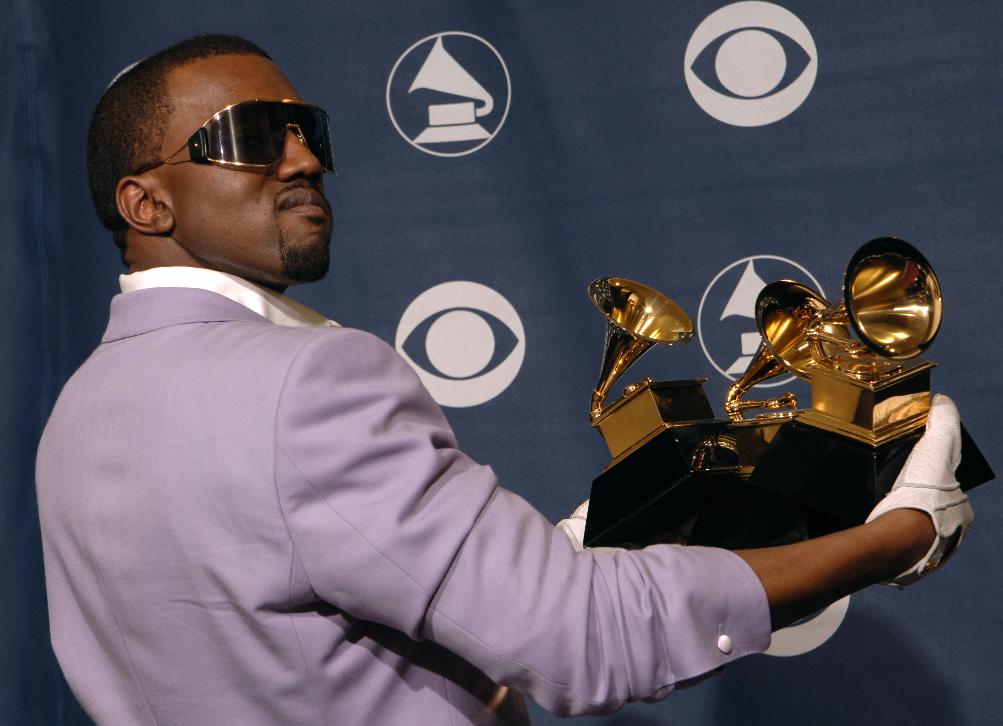 Los Angeles, UNITED STATES: US rapper Kanye West poses with the three awards he won at the Grammy Awards in Los Angeles 08 February 2006. West won for best rap solo performance, best rap song and best rap album. AFP PHOTO/Susan GOLDMAN (Photo credit should read SUSAN GOLDMAN/AFP/Getty Images)